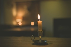42883379 - a lit candle on a table in a dining room